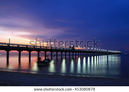 Harbor and Sea view on morning time before sunrise with silhouette fishing pier on foreground,Close up,select focus with shallow depth of field:ideal use for background