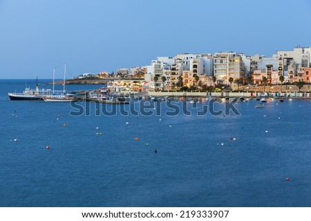 Harbor and view to Bugibba at the St Paul Bay at night on the Island of Malta