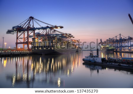 Harbor at night in Hamburg, Germany. Container terminal with container cargo ships. - stock photo