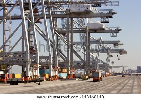 Harbor container cranes and robot trucks.