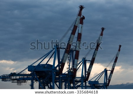 harbor cranes for loading containers - stock photo