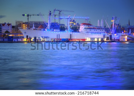 Harbor of Hamburg - illuminated in blue. - stock photo