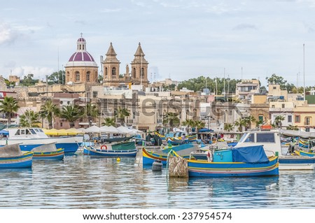 Harbor of Marsaxlokk, a traditional fishing village located in the south-eastern part of Malta. - stock photo
