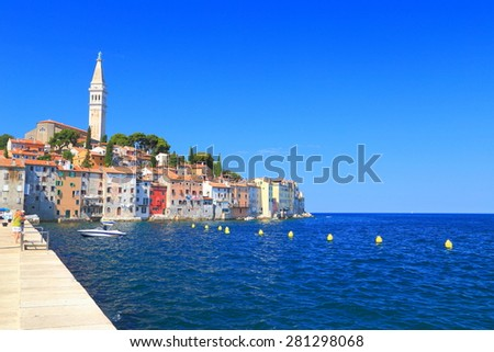 Harbor of old Venetian town with spaces for the boats, Rovinj, Croatia - stock photo