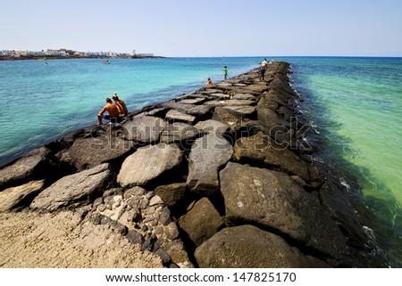harbor pier boat in the blue sky   arrecife teguise lanzarote spain  - stock photo