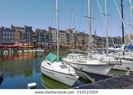 Harbor scene at the little port of Honfleur in Normandy, France