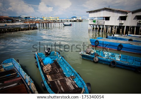 Harbor view from one of the Clan Jetties in historic George Town, Penang, Malaysia - stock photo