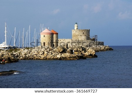 Harbor wall in Rhodes with sail boats inside