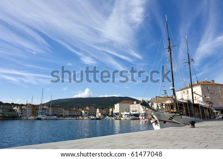 Harbor with old sailing ship in cres on island cres in croatia - stock photo