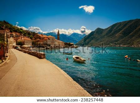 Harbour and boats at Boka Kotor bay (Boka Kotorska), Montenegro, Europe. Image with retro toning. - stock photo