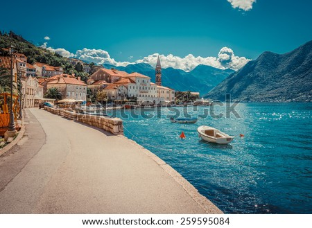 Harbour and boats in sunny day at Boka Kotor bay (Boka Kotorska), Montenegro, Europe. Retro toned image. - stock photo