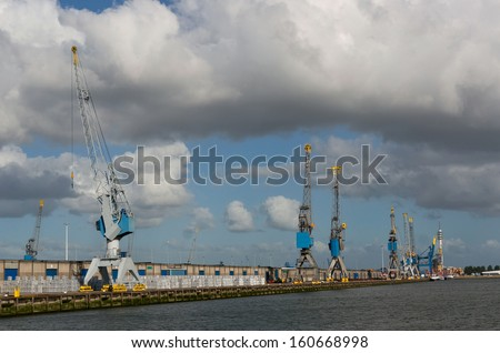 Harbour cranes in Rotterdam port, Netherlands