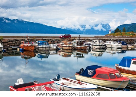 Harbour with boats on Norway fjord. - stock photo