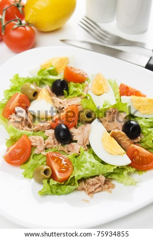 Hard boiled egg salad with tuna meat, tomato, lettuce and olives