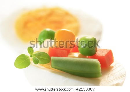 hard-boiled egg with vegetables mix, delicatessen goods, studio isolated on the white background - stock photo