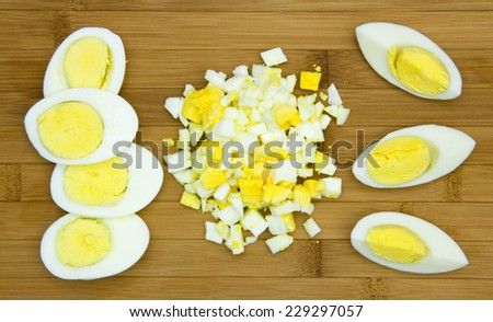 Hard boiled eggs on a wooden board