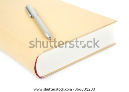 Hard cover book and pen isolated on the white