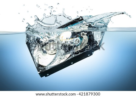 hard disc drive splashes into water - stock photo