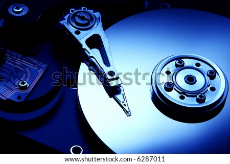 Hard disk detail with a blue hue to accentuate the coldness of technology
