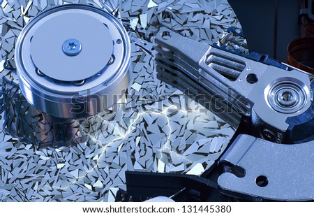 Hard disk detail with a blue hue with surface splinters - stock photo