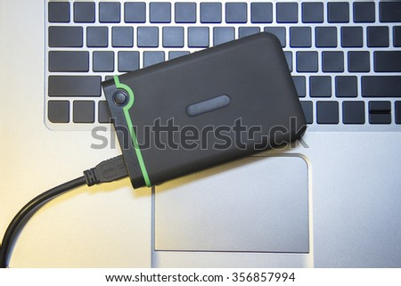 Hard disk on the notebook - stock photo