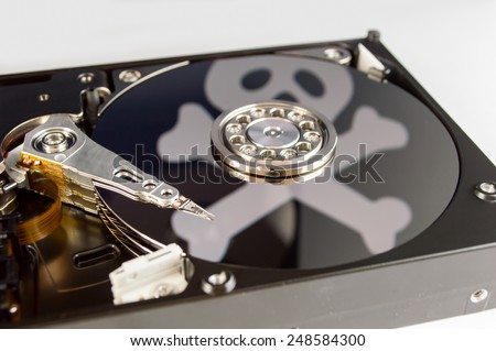 hard disk with a pirate symbol like concept as digital piracy  - stock photo