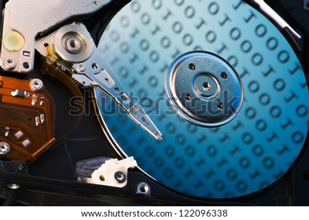 Hard disk with digital data show on the disk. Concept for storing information or data saving - stock photo