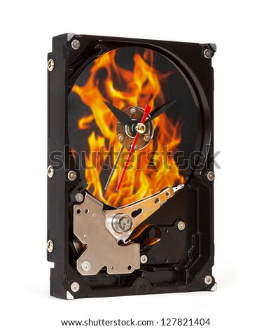 Hard disk with hours and fire reflection - stock photo