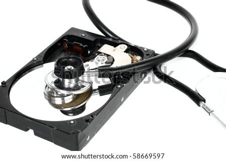 Hard disk with stethoscope isolated on white background - stock photo