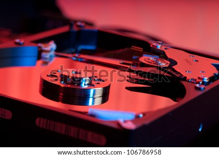 Hard drive closeup on a under a red light - stock photo