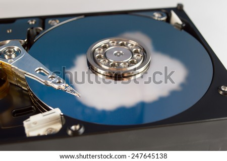 Hard drive disk cloud reflection - stock photo