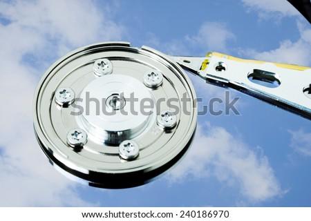 Hard drive disk sky reflection  - stock photo