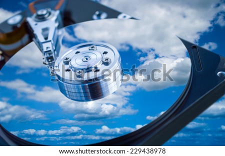 Hard drive disk with sky reflection close-up - stock photo