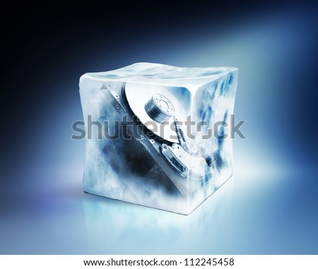 Hard drive frozen in ice cube, data storage concept, isolated path included - stock photo