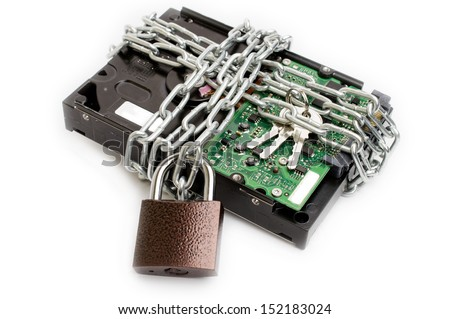 Hard drive secured by chain and padlock - stock photo