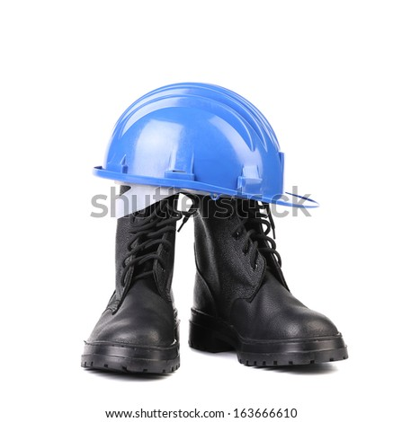 Hard hat and working boots. Isolated on a white background. - stock photo