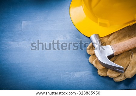 Hard hat claw hammer protective gloves copy space construction concept. - stock photo