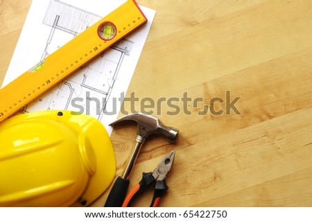 hard hat hammer and tools with copyspace showing home worker concept - stock photo