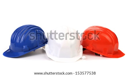 Hard hat of different colors like a flag France. - stock photo