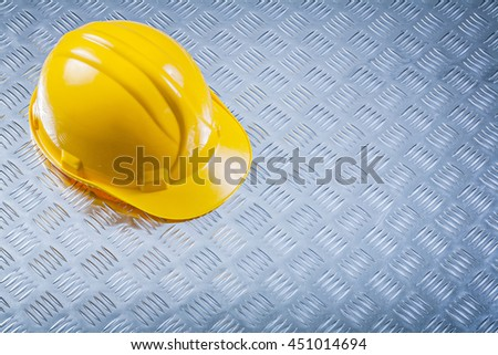 Hard hat on corrugated metal sheet construction concept. - stock photo