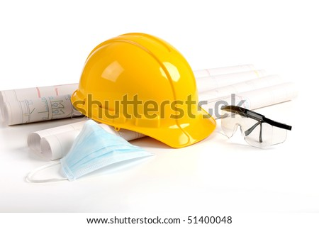 Hard hat, plans and safety protection equipment in the construction industry - stock photo