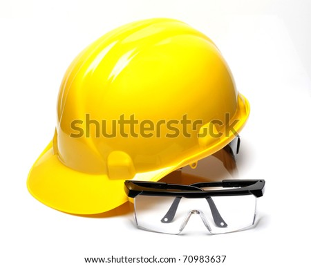 Hard hat with a pair of safety glasses