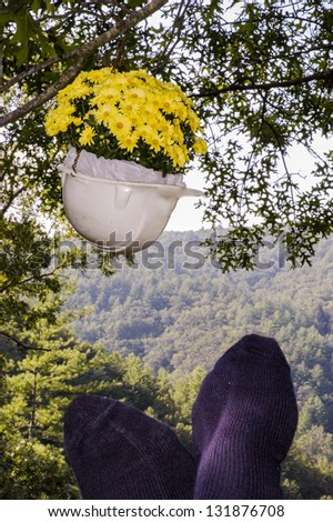 Hard hat with flowers. - stock photo