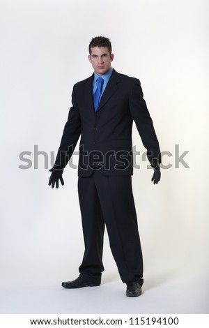 hard looking man wearing gloves not someone to be trifled with - stock photo