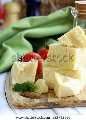 Hard natural parmesan cheese on a wooden board - stock photo