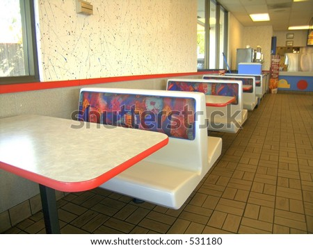Hard plastic booths found in fast food dining room - stock photo