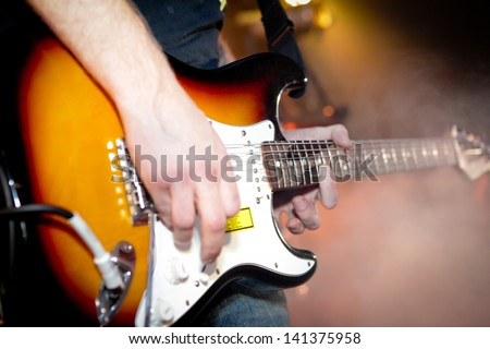 Hard rock musicians playing at a concert - stock photo