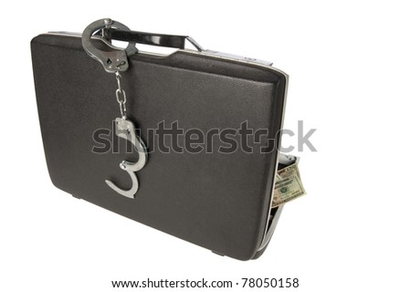 Hard-shell briefcase with stack of $20 U.S. bills visisble, handcuffs on the handle, isolated on a white background