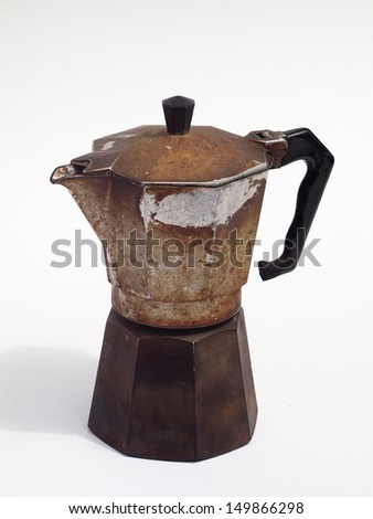 hard sloughed used old espresso coffee pot machine italian retro style hard light with light shadow - stock photo