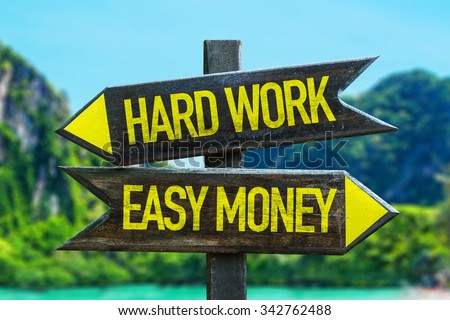 Hard Work - Easy Money signpost in a beach background - stock photo